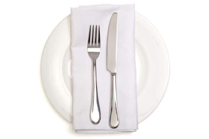White napkin on plate wiht white background