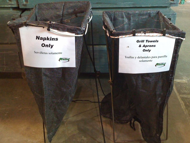 Soil bags with signs attached. Our soil bags are made up of a mesh-type material to reduce damage caused by mildew.