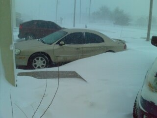 Cars getting surrounded with snow. Picture taken by Bryon Long